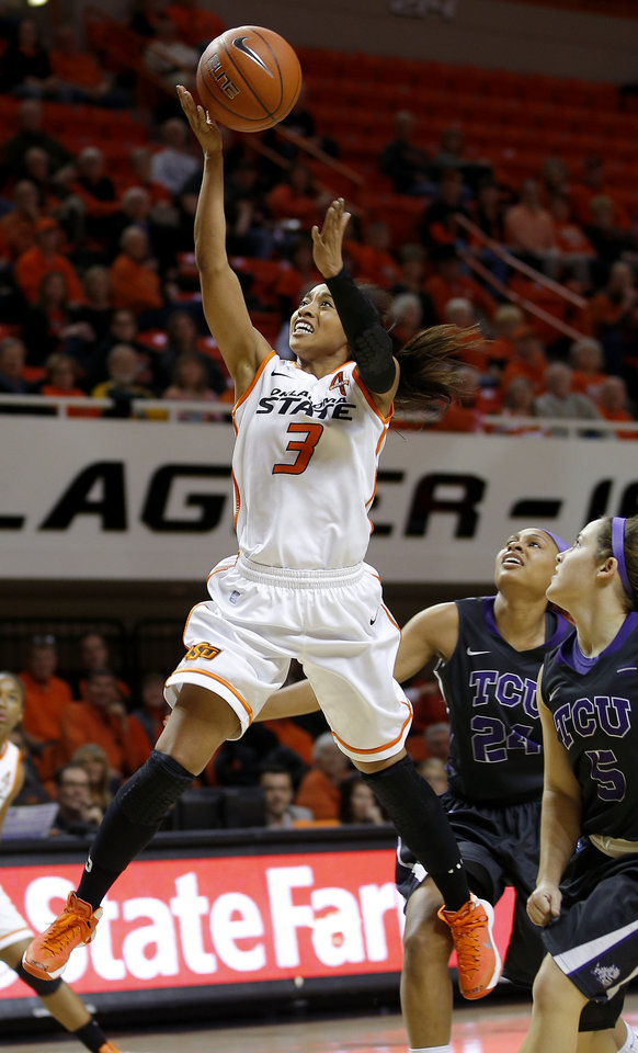 OSU�s Tiffany Bias scores past TCU�s Natalie Ventress, center, and Meagan Henson, right, during a Cowgirls� win last week. Photo by Bryan Terry, The Oklahoman