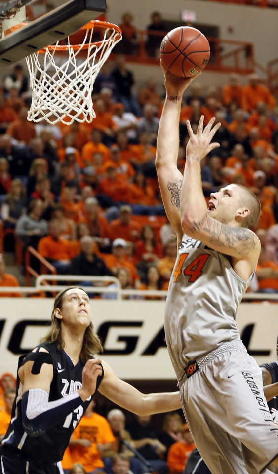 Oklahoma State's Philip Jurick (44) shoots against Gonzaga's Kelly Olynyk (13) during a men's college basketball game between Oklahoma State University (OSU) and Gonzaga at Gallagher-Iba Arena in Stillwater, Okla., Monday, Dec. 31, 2012. Photo by Nate Billings, The Oklahoman