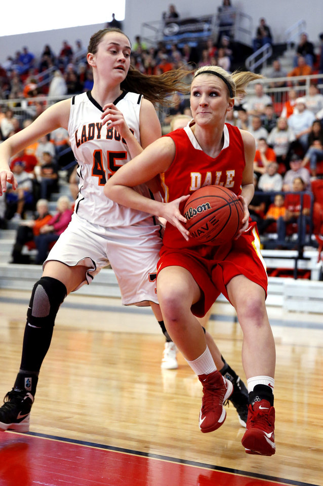 Photo - Dale's Breck Clark, right, tries to drive past Taylor McAreavey as the Tonkawa Lady Bucs play the Dale Lady Pirates in class 2A State Playoff girls basketball at Westmoore High School on Thursday, March 7, 2013, in Moore, Okla. Photo by Steve Sisney, The Oklahoman
