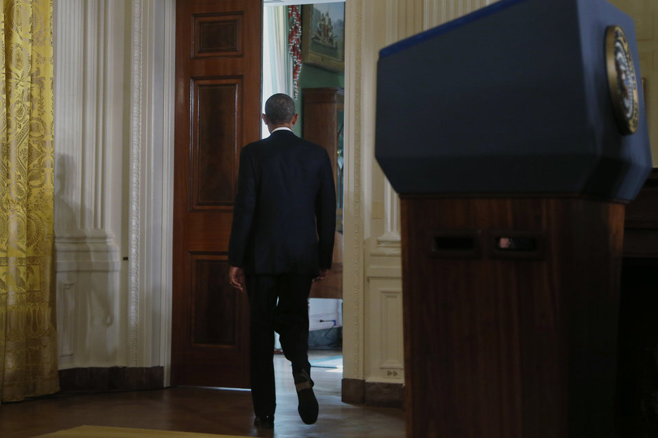 Photo - President Barack Obama walks out of the East Room into the Green Room of the White House in Washington after he spoke about benefits for the unemployed, Tuesday, Jan. 7, 2014. The president applauded a Senate vote advancing legislation to renew jobless benefits for the long-term unemployed as an important step. The Senate voted 60-37 Tuesday to clear the bill's first hurdle. But Republicans who voted to move ahead still want concessions that will have to be worked out before final passage. The Republican-controlled House would also have to vote for it.  (AP Photo/Charles Dharapak)