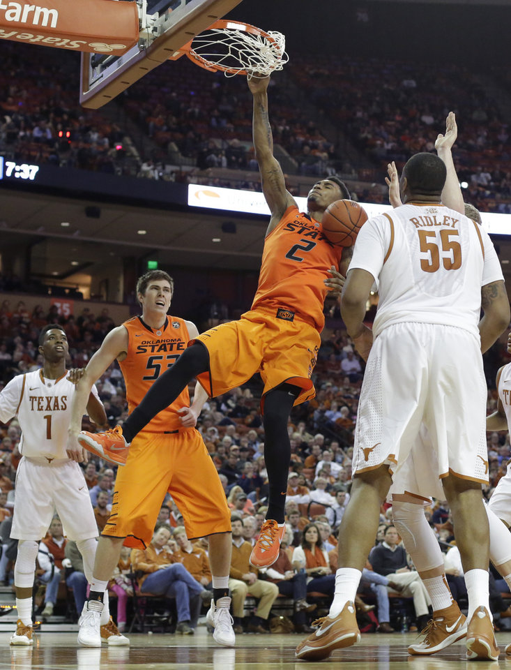 Photo - Oklahoma State's Le'Bryan Nash (2) scores against Texas during the second half on an NCAA college basketball game, Tuesday, Feb. 11, 2014, in Austin, Texas. Texas won 87-68. (AP Photo/Eric Gay)