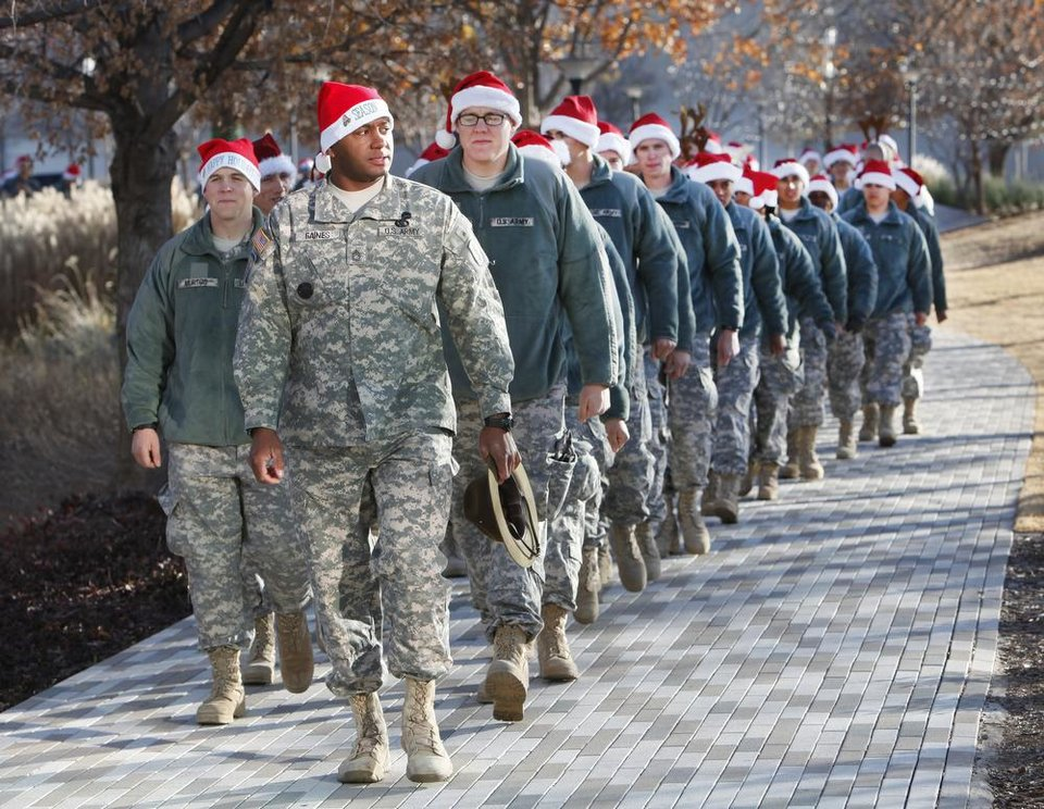 Solders march from breakfast to the Crystal Bridge at the Myriad Gardens during Soldiers Day Out, Friday, December 21, 2012. Edmond/North OKC Blue Star Mothers will be taking the soldiers who can't go home for Christmas around the metro for a day of fun. Photo By David McDaniel/The Oklahoman
