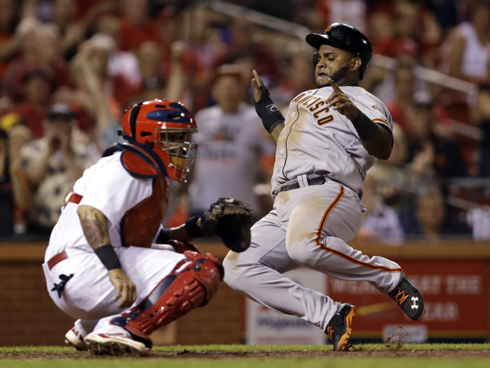 Photo - San Francisco Giants' Pablo Sandoval, right, scores on a two-run double by Michael Morse as St. Louis Cardinals catcher Yadier Molina looks for the throw during the eighth inning of a baseball game Thursday, May 29, 2014, in St. Louis. (AP Photo/Jeff Roberson)