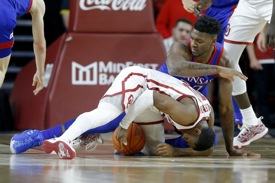 Photo - Oklahoma's De'Vion Harmon (11) fights for the ball in front of Kansas' Silvio De Sousa (22) during an NCAA college basketball game between the University of Oklahoma Sooners (OU) and the University of Kansas Jayhawks at Lloyd Noble Center in Norman, Okla., Tuesday, Jan. 14, 2020. [Bryan Terry/The Oklahoman]