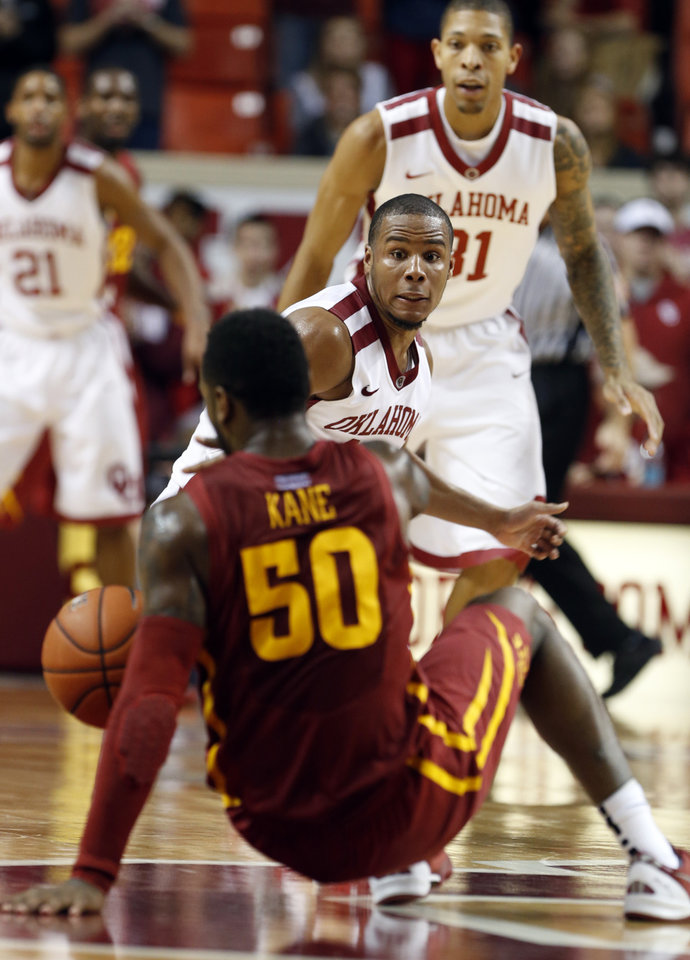 Oklahoma Sooner's Jordan Woodard (10) watches as Iowa State Cyclone's DeAndre Kane (50) loses the ball as the University of Oklahoma Sooners (OU) men defeat the Iowa State Cyclones (ISU) 87-82 in NCAA, college basketball at The Lloyd Noble Center on Saturday, Jan. 11, 2014  in Norman, Okla. Photo by Steve Sisney, The Oklahoman