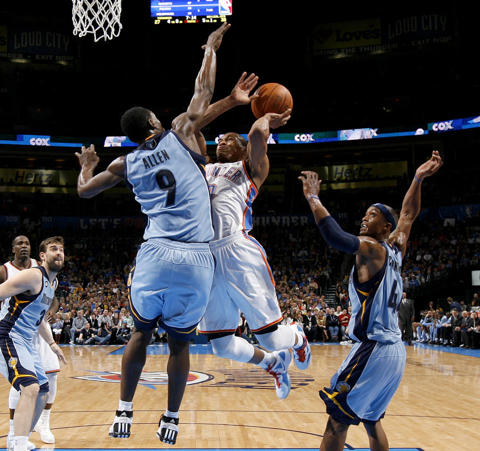 Oklahoma City's Russell Westbrook (0) goes between Memphis' Tony Allen (9) and Dante Cunningham (44) during the NBA game between the Oklahoma City Thunder and the Memphis Grizzlies at Chesapeake Energy Arena in Oklahoma CIty, Friday, Feb. 3, 2012. Photo by Bryan Terry, The Oklahoman