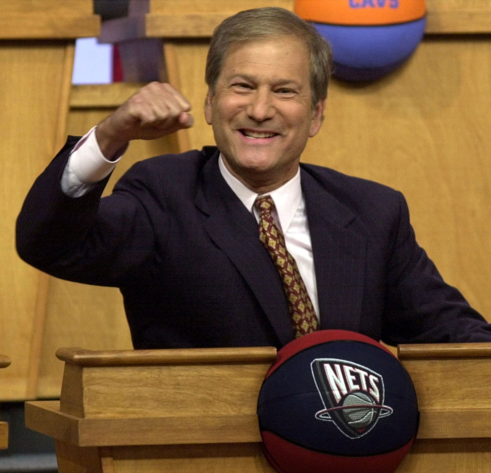 Photo - FILE - In this May 21, 2000 file photo, New Jersey Nets owner Lewis Katz reacts as the Nets received the first pick in the NBA draft  at the NBA Draft Lottery in Secaucus, N.J.   The editor of The Philadelphia Inquirer says co-owner Lewis Katz is among the seven people killed in a plane crash in Massachusetts.  Bill Marimow confirmed Katz's death to Philly.com on Sunday, June 1, 2014 saying he learned the news from close associates.  The plane crashed and caught fire as it was leaving Hanscom Field while on its way to Atlantic City International Airport. Massachusetts Port Authority spokesman Matthew Brelis says there were no survivors in the crash.  (AP Photo/Bill Kostroun)