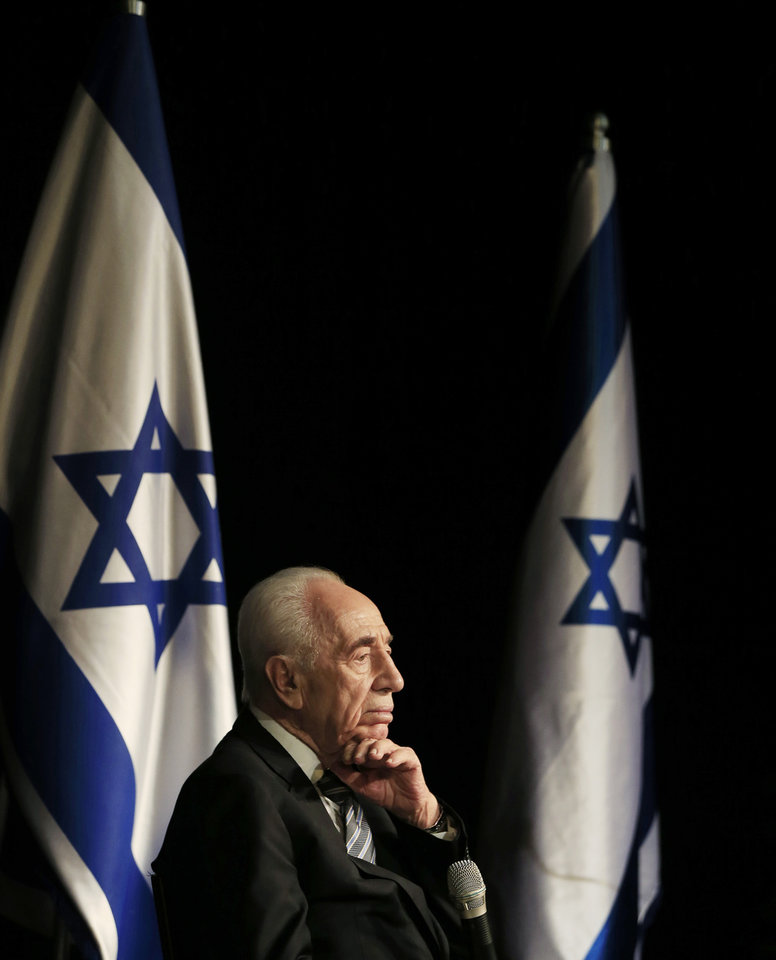 Photo - Israeli President Shimon Peres talks during a visit in the southern Israeli town of Sderot, Israel, Sunday, July 6, 2014. Peres met with local residents enduring the ongoing rocket barrages from neighboring Gaza. (AP Photo/Tsafrir Abayov)