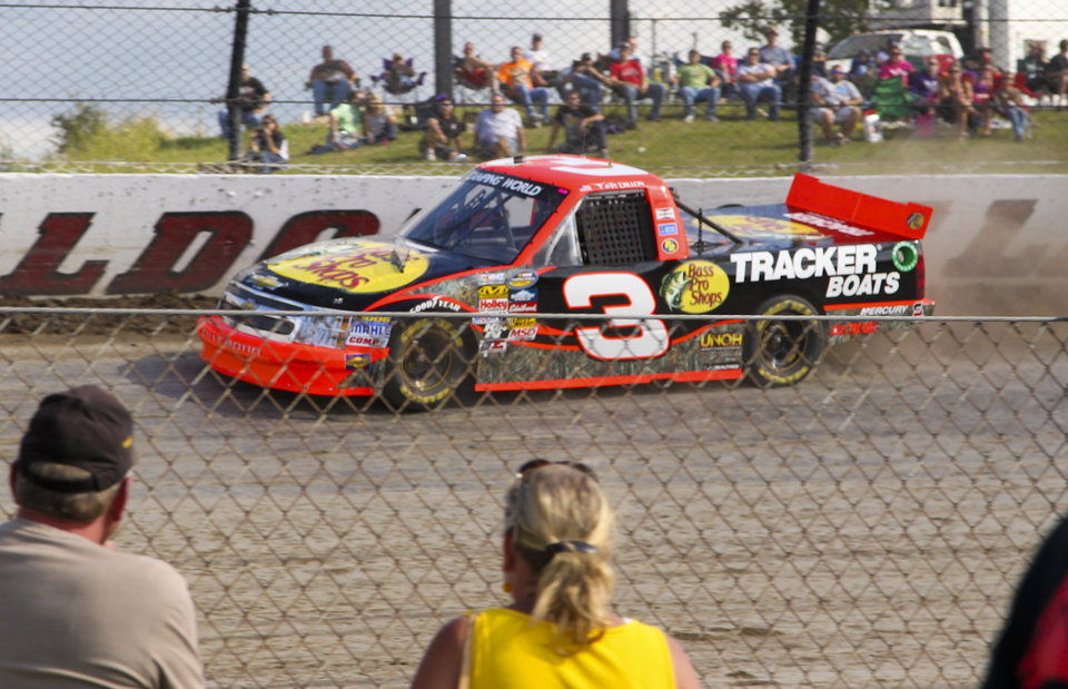 Photo - Ty Dillon runs a qualifying lap for the inaugural Mudsummer Classic NASCAR Trucks Series race at Eldora Speedway, Wednesday, July 24, 2013, in Rossburg, Ohio. (AP Photo/The Dayton Daily News, Greg Lynch)  LOCAL PRINT OUT; LOCAL TV OUT; WKEF-TV OUT; WRGT-TV OUT; WDTN-TV OUT