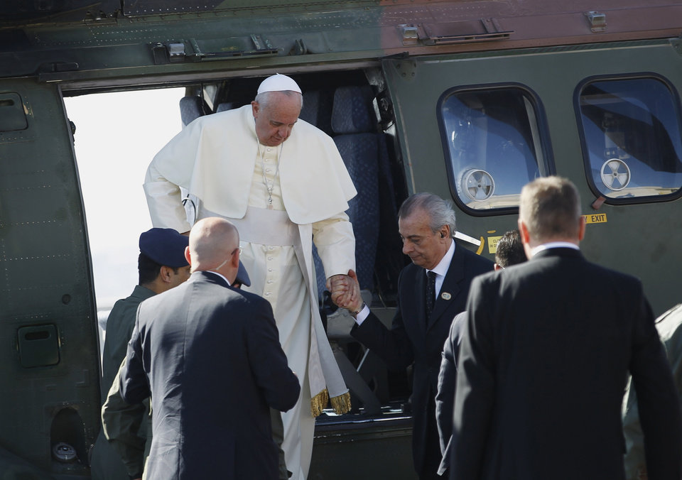 Photo - Pope Francis alights from a helicopter upon his arrival at the West Bank town of Bethlehem on Sunday, May 25, 2014. Pope Francis landed Sunday in the West Bank town of Bethlehem in a symbolic nod to Palestinian aspirations for their own state as he began a busy second day of his Mideast pilgrimage. (AP Photo/Mohamad Torokman, Pool)