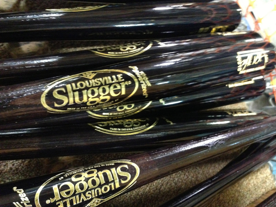 Photo - In this Thursday, March 28, 2013 photo, Louisville Slugger baseball bats are shown, in Louisville, Ky. Louisville Slugger is rolling out a new logo for the first time in 33 years on a new bat that company officials say is designed to be the hardest wooden bat ever produced at the Louisville, Ky., factory. The new logo and bat will debut on Opening Day games in Major League Baseball. (AP Photo/Brett Barrouquere)