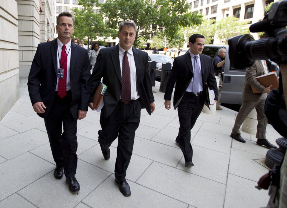 Photo - Assistant U.S. Attorney Michael DiLorenzo, center, lead prosecutor in the federal case against Libyan militant Ahmed Abu Khattala, accused of masterminding the deadly Benghazi attacks, enters the federal U.S. District Court in Washington Saturday, June 28, 2014, with his team.  (AP Photo/Jose Luis Magana)