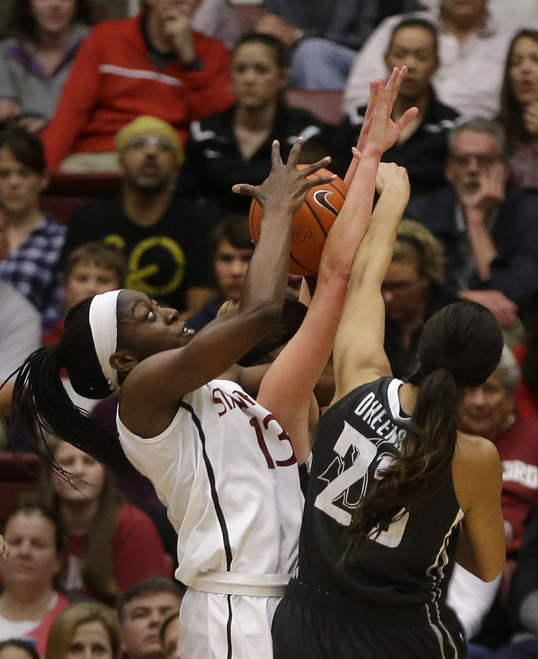 Photo - Stanford's Chiney Ogwumike (13) rebounds against Washington State's Shalie Dheensaw during the first half of an NCAA college basketball game Saturday, March 1, 2014, in Stanford, Calif. (AP Photo/Ben Margot)
