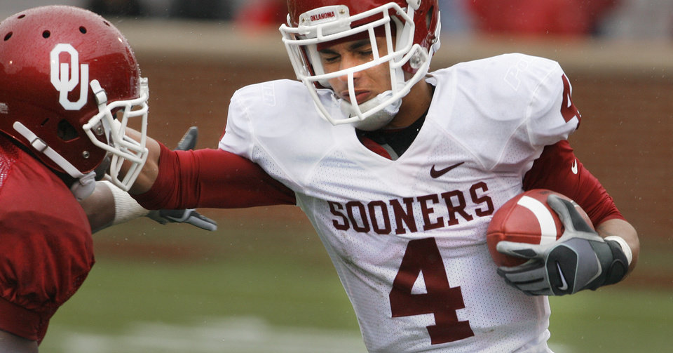 Photo - Javon Harris (left) tackles Kenny Stills (4) during the spring Red and White football game for the University of Oklahoma (OU) Sooners at Gaylord Family/Oklahoma Memorial Stadium on Saturday, April 17, 2010, in Norman, Okla.  Photo by Steve Sisney, The Oklahoman