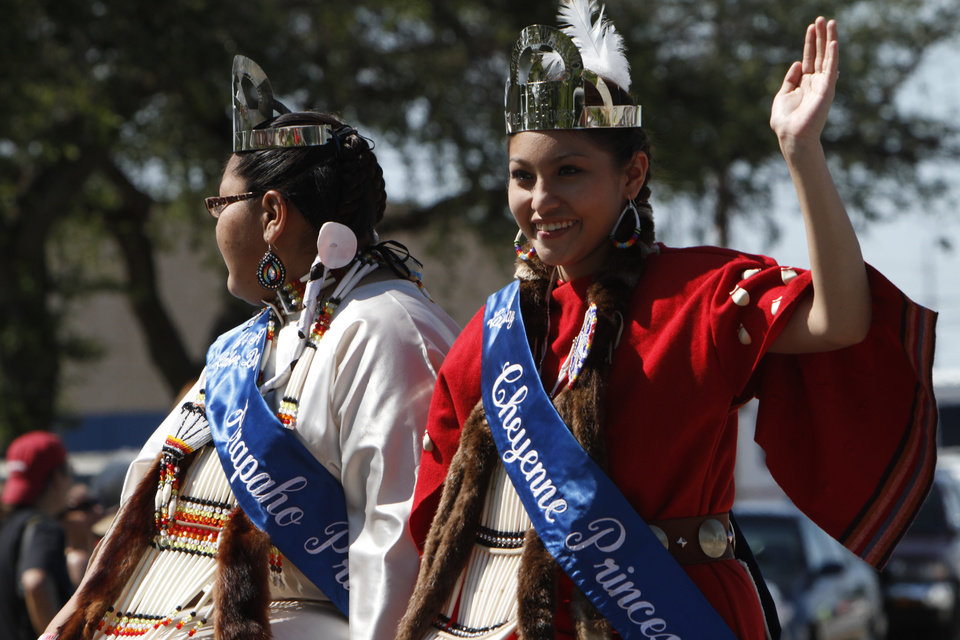 Alicia Reed waves to the crowd as she rides through downtown Oklahoma City during the Red Earth parade on Friday, June 7, 2013. Reed is the Cheyenne Princess for the 2013-2014 Cheyenne and Arapaho Labor Day Powwow. Photo by Aliki Dyer, The Oklahoman