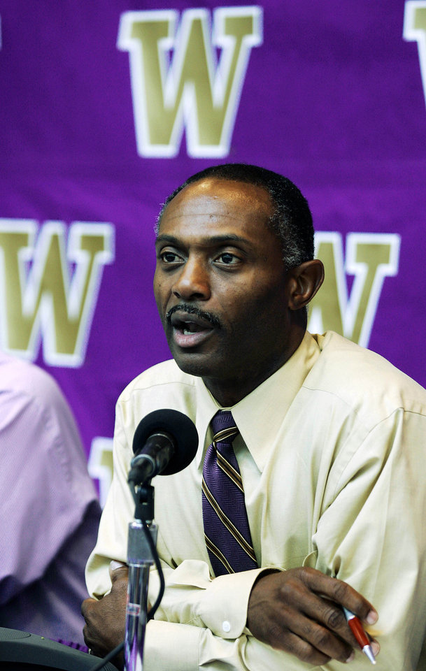 Photo - University of Washington head college football coach Tyrone Willingham answers questions from reporters Monday, Sept. 19, 2005 about the upcoming game against Notre Dame in Seattle. Willingham and the Huskies will face a week of media scrutiny as they prepare to meet Willingham's former team on Saturday. (AP Photo/Ted S. Warren)