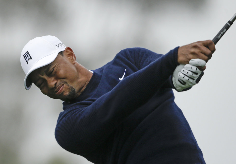 Photo - Tiger Woods tees off on the 11th hole of the North Course at Torrey Pines during the second round of the Farmers Insurance Open golf tournament Friday, Jan. 24, 2014, in San Diego. (AP Photo/Lenny Ignelzi)