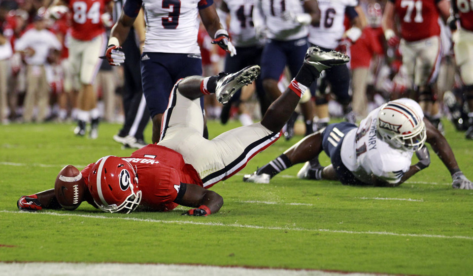 Photo -   Georgia running back Keith Marshall (4) is stopped short of the goal line by Florida Atlantic linebacker Cory Henry (31) during the first half of an NCAA college football game Saturday, Sept. 15, 2012, in Athens, Ga. (AP Photo/John Bazemore)
