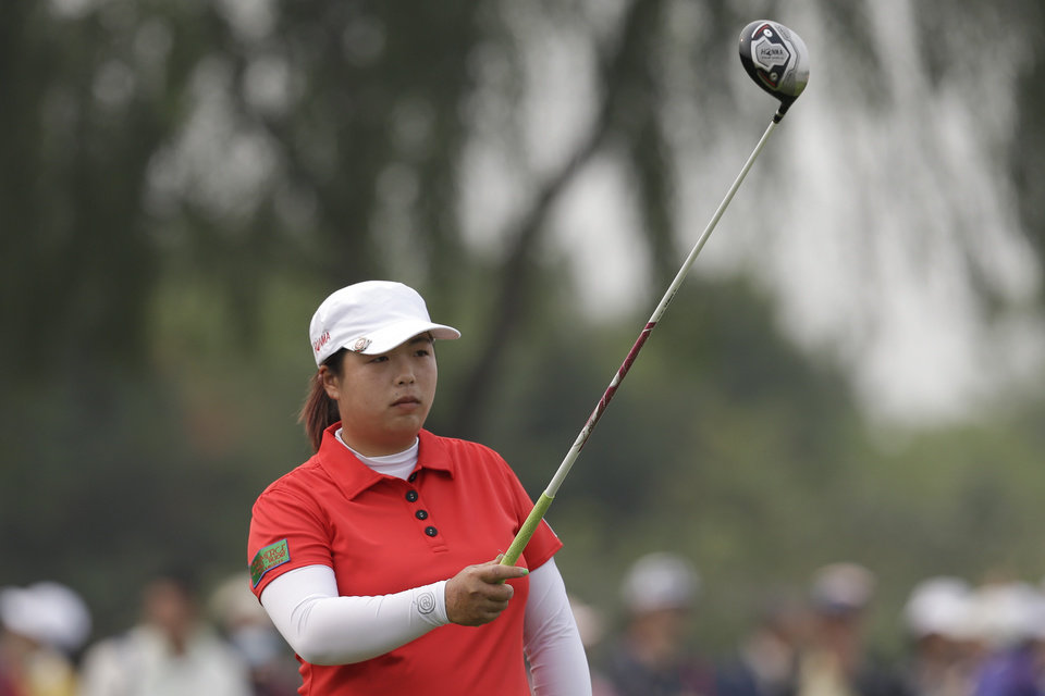 China's Shanshan Feng takes aim before she tees off on the forth hole during the final round of the Reignwood LPGA Classic golf tournament at Pine Valley Golf Club on the outskirts of Beijing, China, Sunday, Oct. 6, 2013. (AP Photo/Alexander F. Yuan)