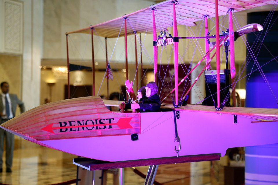 Photo - A model of the aircraft that made the historic trip a century ago is on display at the 70th International Air Transport Association (IATA) in Doha, Qatar, Monday, June 2, 2014. The aviation industry is marking 100 years since the first scheduled commercial flight took off, making a 23-minute journey across Florida's Tampa Bay. (AP Photo/Osama Faisal)