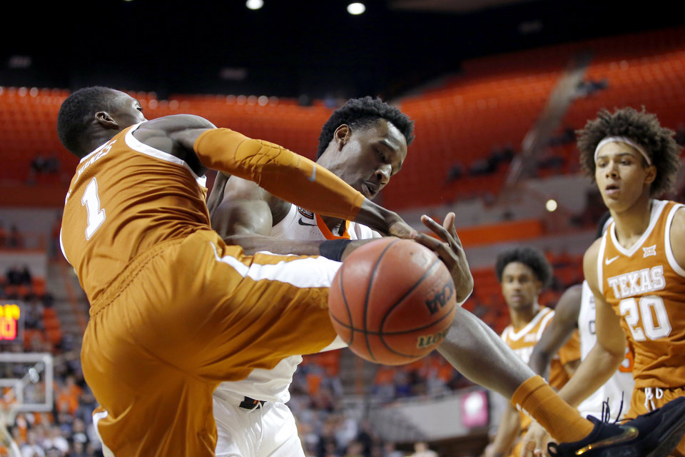 Photo - Oklahoma State's Cameron McGriff (12) goes for the ball behind Texas' Andrew Jones (1) during an NCAA basketball game between the Oklahoma State University Cowboys (OSU) and the Texas Longhorns at Gallagher-Iba Arena in Stillwater, Okla., Wednesday, Jan. 15, 2020. Oklahoma State lost 76-64. [Bryan Terry/The Oklahoman]