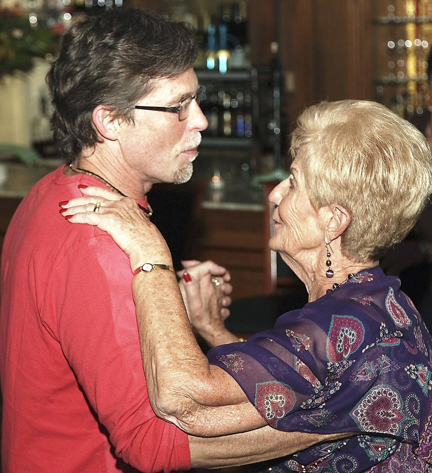 Rick Bayless dances with his mother, Levita Anderson, at her 80th birthday party in 2006 at Metro Wine Bar and Bistro. Bayless leased the restaurant and brought a helper and food from his Chicago restaurant Frontera for the night. PHOTO PROVIDED
