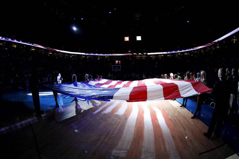 Photo - The flag is displayed before the NBA basketball game between the Oklahoma City Thunder and the Washington Wizards at the Ford Center in Oklahoma City, Wed., March 4, 2009. PHOTO BY BRYAN TERRY, THE OKLAHOMAN