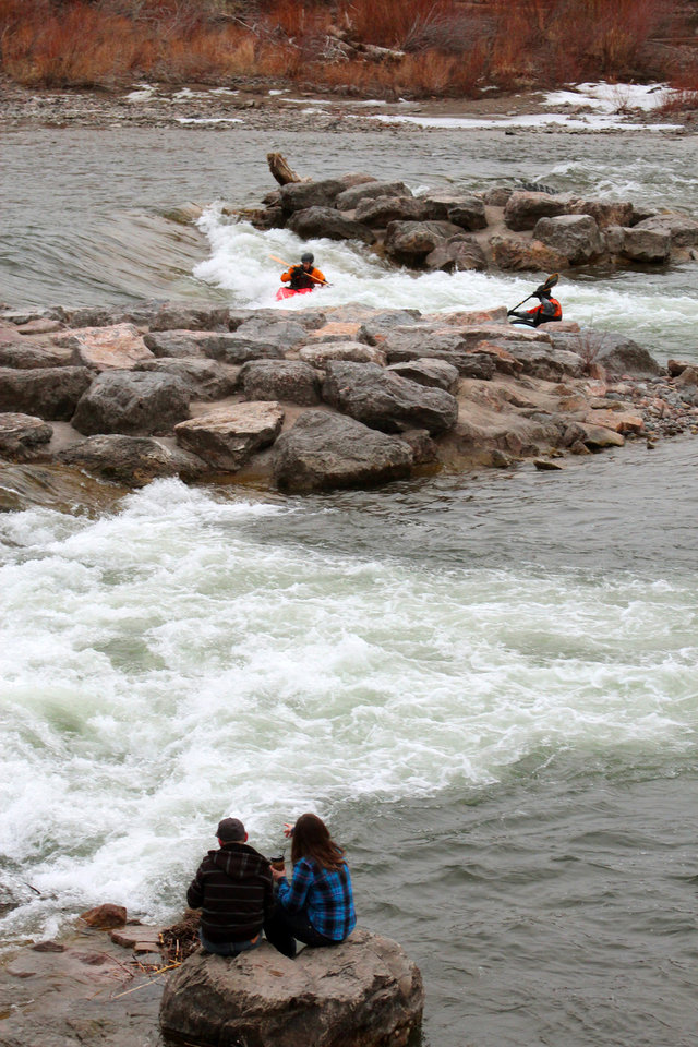 Photo - This March 2, 2013 photo shows kayakers enjoying the froth on the Clark Fork River in Missoula, Mont. For tourists, Missoula offers a number of things to do, including touring the smokejumper base where parachuting firefighters are trained as well as hiking Mount Sentinel and fishing and boating on the river. (AP Photo/Ron Zellar)