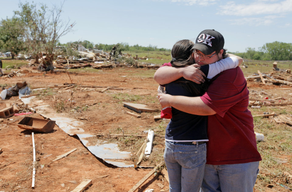 Andrea Rush, left, gets a hug from Timothy Walser at the Hide-A-Way Mobile Home Park in Woodward, Okla., Monday, April 16, 2012. Rush's friend, Steve Peil, was killed by a tornado that struck the town early Sunday morning. Members of Walser's family knew Peil. Walser was at the site helping to clean up the debris from destroyed homes, including one in which his cousins lived. Photo by Nate Billings, The Oklahoman