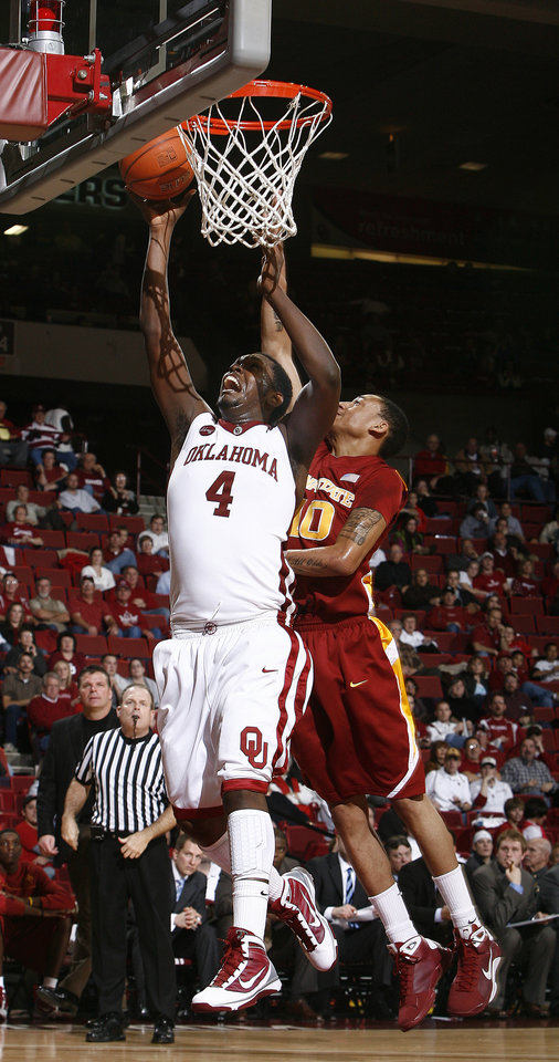 Photo - OU's Andrew Fitzgerald (4) shoots over Diante Garrett (10) during the college men's basketball game between the University of Oklahoma and Iowa State, Wednesday, Jan. 27, 2010, at the Lloyd Noble Center in Norman, Okla.