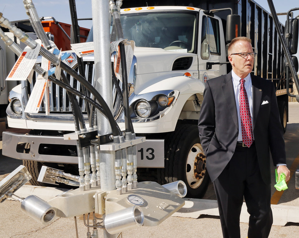 Photo -  Jim Linn, Oklahoma City's superintendent of the solid waste management division, talks about the slow-fill CNG pumps at the new CNG fueling station Wednesday at Oklahoma City's Solid Waste Facility. Photo by Nate Billings, The Oklahoman   NATE BILLINGS -