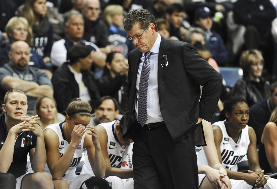 Connecticut head coach Geno Auriemma reacts during the second half of an NCAA college basketball game against Notre Dame in Storrs, Conn., Saturday, Jan. 5, 2013. Notre Dame won 73-72. (AP Photo/Jessica Hill)