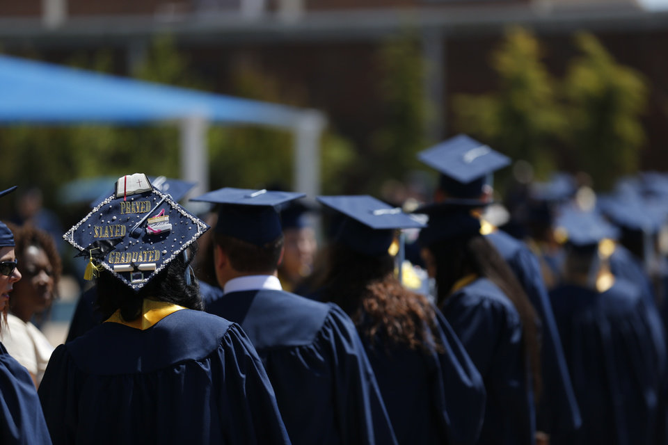 Photo -  Students walk to graduation ceremonies for College of Education and Professional Studies at Edmond's University of Central Oklahoma. [PHOTO BY SARAH PHIPPS, THE OKLAHOMAN]