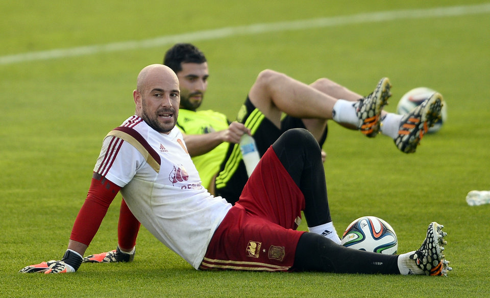 Photo - Spain's goalkeeper Pepe Reina, left, and Raul Albiol attend a training session at the Atletico Paranaense training center in Curitiba, Brazil, Saturday, June 14, 2014. Spain will play in group B of the Brazil 2014 World Cup. (AP Photo/Manu Fernandez)