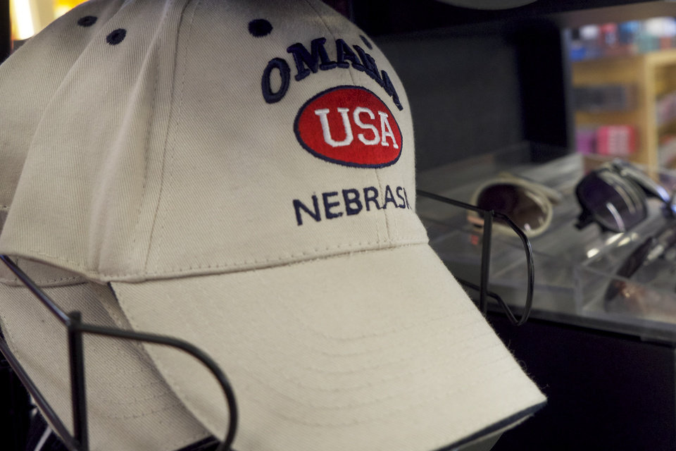 Photo - In this photo taken on Monday, Jan. 20, 2014, a ball cap embroidered with Omaha sits on a display rack in an concourse shop in the Omaha Airport in Omaha, Neb.