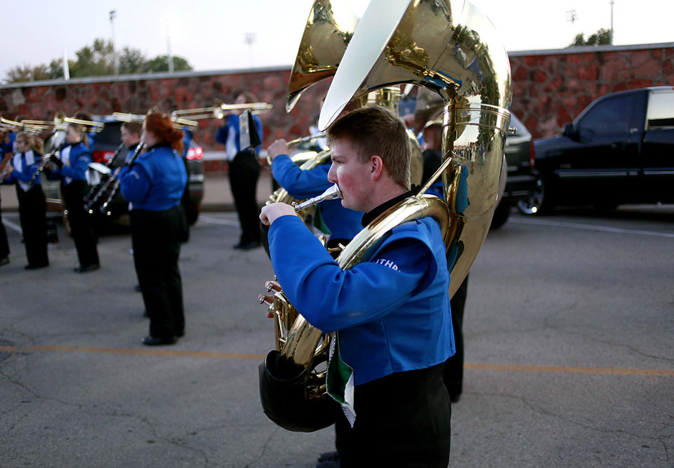JELSMA STADIUM / THE ROCK / STADIUM / HIGH SCHOOL FOOTBALL: Chris Stum, a junior in Guthrie High School, stands on Harrison Street as he performs with the band before Guthrie's game against Western Heights in Guthrie on Friday, Oct. 28, 2011. Harrison Street is blocked off for pre-game festivities on game days. Photo by John Clanton, The Oklahoman ORG XMIT: KOD