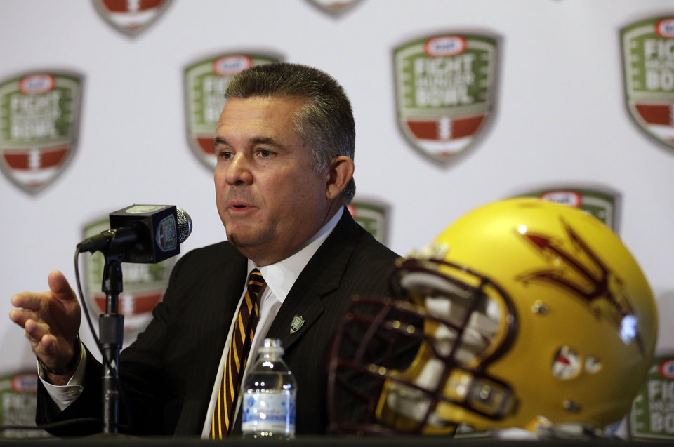 Photo - Arizona State head coach Todd Graham speaks during a news conference ahead of the Fight Hunger Bowl NCAA college football game in San Francisco, Wednesday, Dec. 26, 2012. Arizona State is to face Navy in the bowl on Saturday. (AP Photo/Marcio Jose Sanchez)