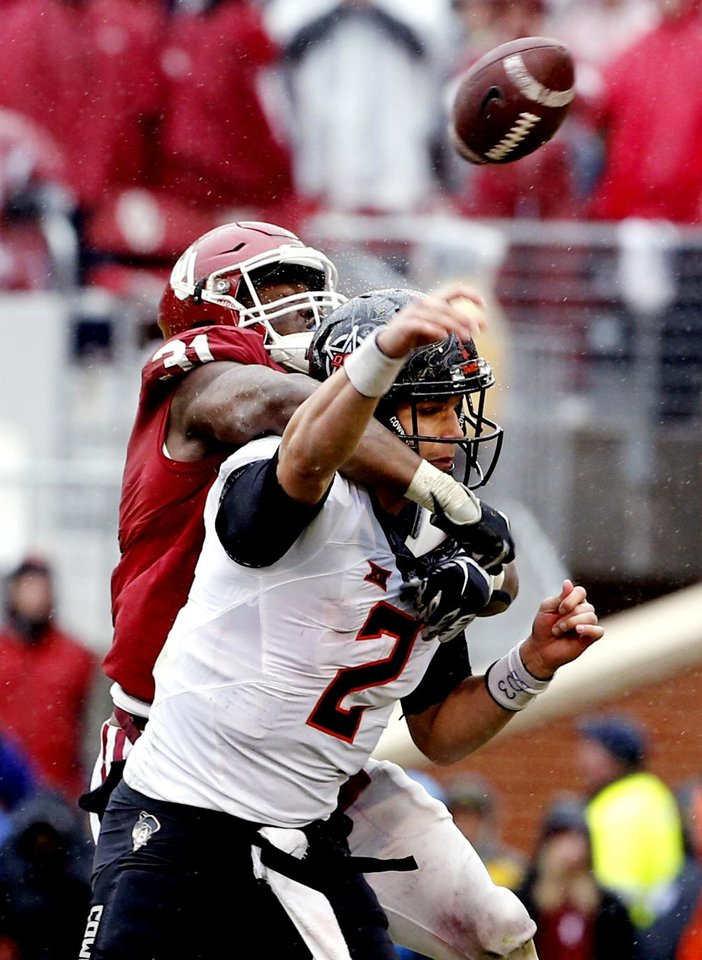 Photo - Oklahoma's Ogbonnia Okoronkwo (31) hits Oklahoma State's Mason Rudolph (2) causing an errant pass and loss of the ball on fourth down late during the second half of the Bedlam college football game between the Oklahoma Sooners (OU) and the Oklahoma State Cowboys (OSU) at Gaylord Family - Oklahoma Memorial Stadium in Norman, Okla., Saturday, Dec. 3, 2016. Photo by Steve Sisney, The Oklahoman