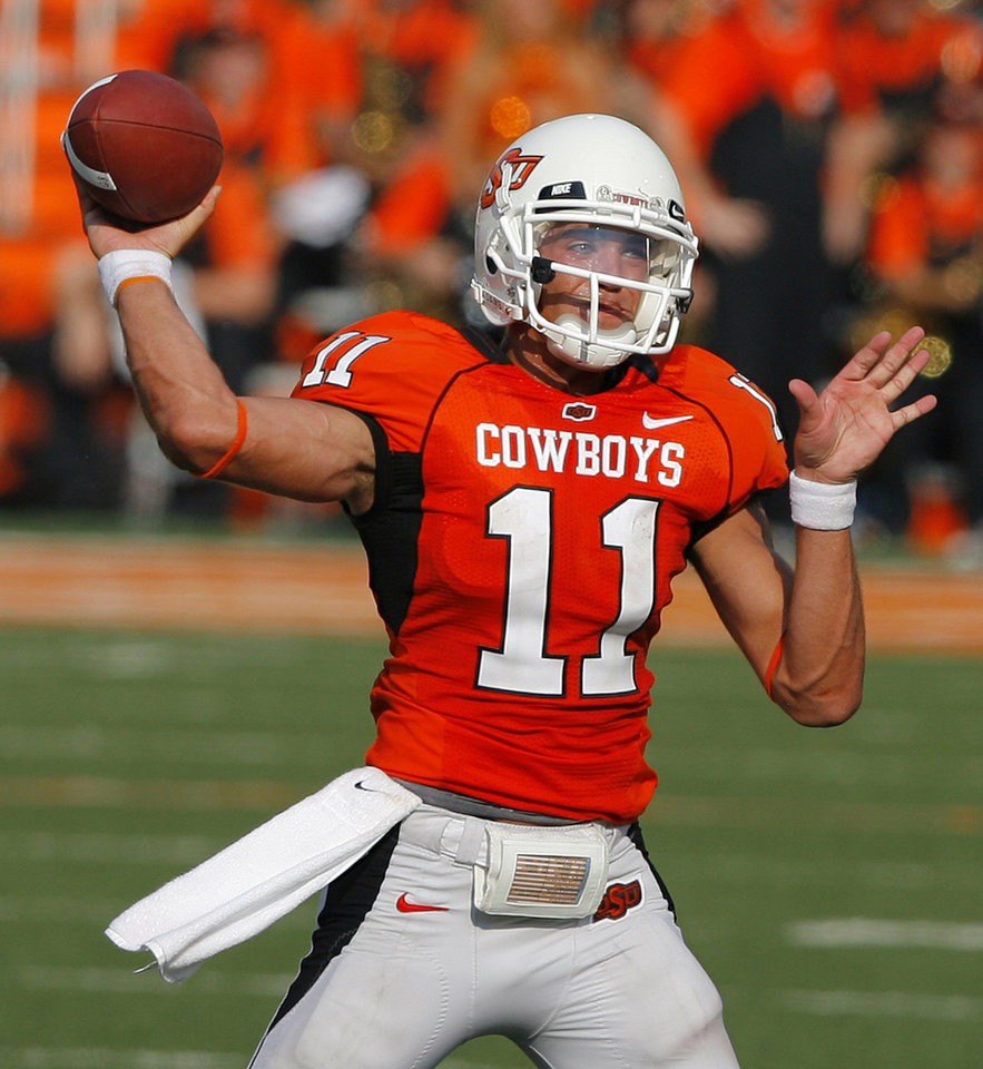 Oklahoma State quarterback Zac Robinson (11) throws the ball against Texas Tech during the second half of the college football game between the Oklahoma State University Cowboys (OSU) and the Texas Tech University Red Raiders (TTU) at Boone Pickens Stadium on Saturday, Sept. 22, 2007, in Stillwater, Okla. By MATT STRASEN, The Oklahoman