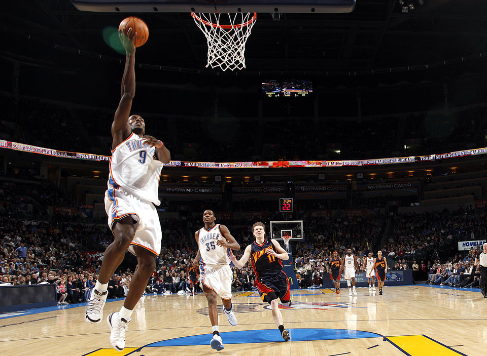 Photo - Oklahoma City's Serge Ibaka (9) shoots a lay up during the NBA game between the Oklahoma City Thunder and Golden State Warriors, Sunday, Jan. 31, 2010, at the Ford Center in Oklahoma City. Photo by Sarah Phipps, The Oklahoman