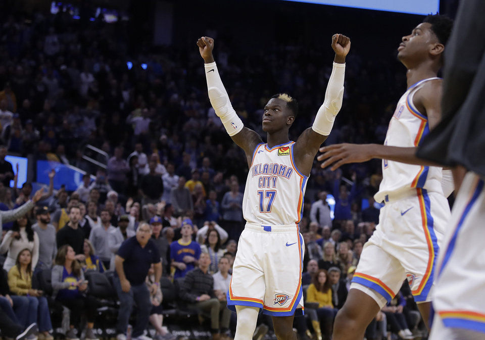 Photo - Oklahoma City Thunder guard Dennis Schroder (17) celebrates at the end of an NBA basketball game against the Golden State Warriors Monday, Nov. 25, 2019, in San Francisco. (AP Photo/Ben Margot)
