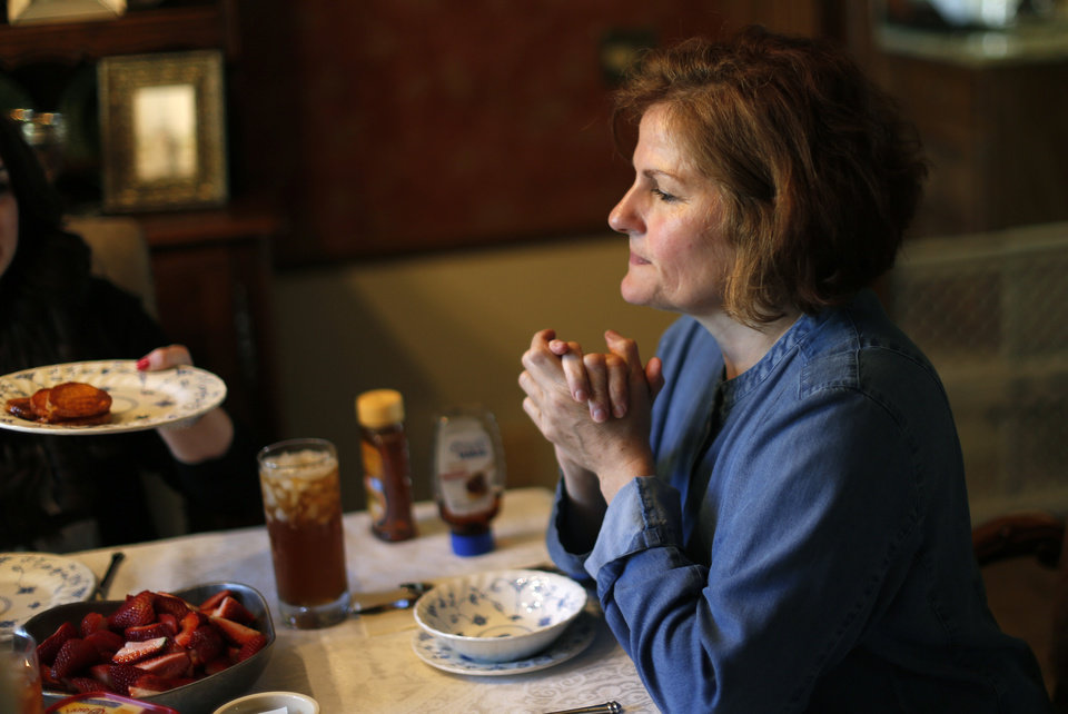 Vicki Behenna watches her family eat dinner in Edmond, Okla.,Sunday, April 28, 2013. Photo by Sarah Phipps, The Oklahoman