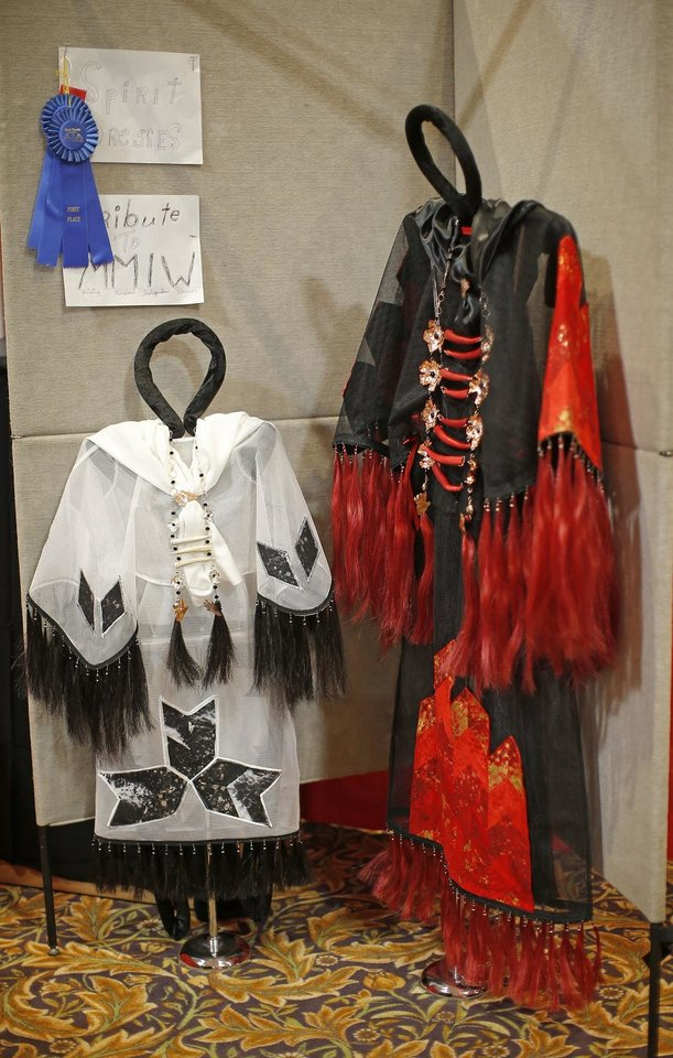 Photo - 2020 Red Earth Honored One Nelda Schrupp won first place in th cultural items category for her spirit dresses honoring missing and murdered Indigenous women and girls at the Red Earth Festival at Grand Event Center at the Grand Casino Hotel & Resort, Saturday, Sept. 5, 2020. [Bryan Terry/The Oklahoman]