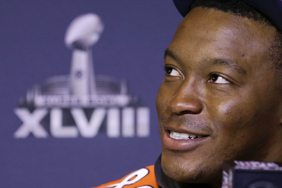 Photo - Denver Broncos wide receiver Demaryius Thomas talks with reporters during a news conference Thursday, Jan. 30, 2014, in Jersey City, N.J. The Broncos are scheduled to play the Seattle Seahawks in the NFL Super Bowl XLVIII football game Sunday, Feb. 2, in East Rutherford, N.J. (AP Photo)