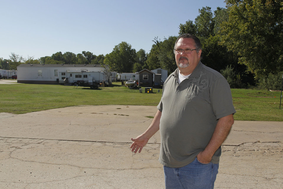 James Womack, director of Hand Up Ministries, talks with members of the Oklahoma Metro Prayer Alliance on the grounds of the Ministry in Oklahoma City, Wednesday, Oct. 3, 2012. Behind Womack are some of the trailers where 150 sex offenders who have been released from prison after serving their sentences are housed. (AP Photo/Sue Ogrocki)