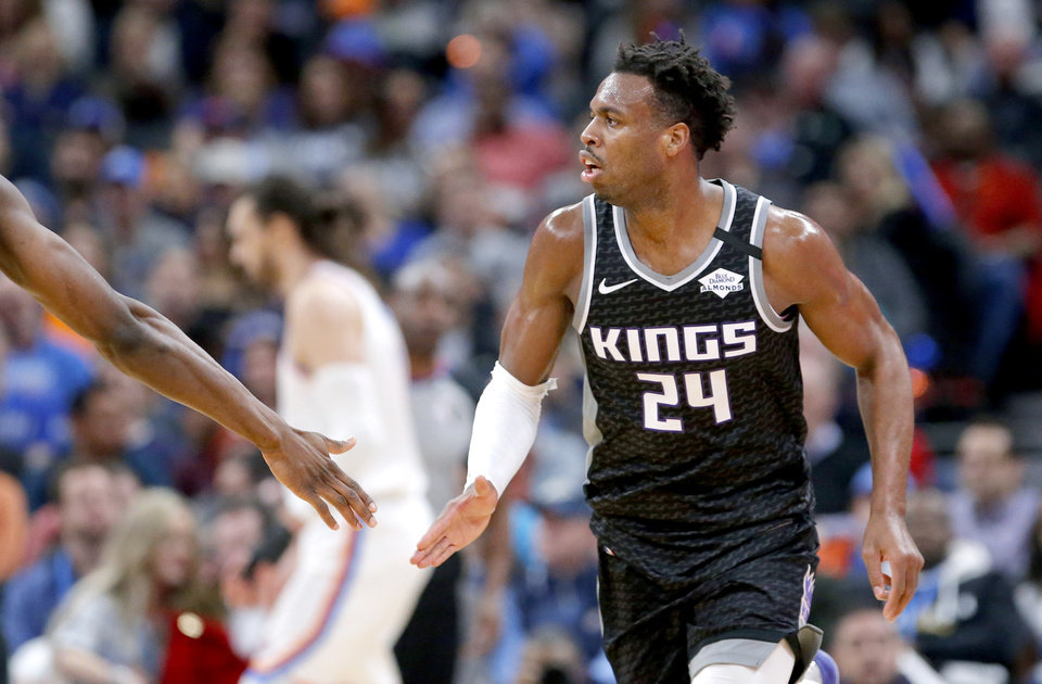 Photo - Sacramento's Buddy Hield (24) reacts after a 3-point basket during the NBA basketball game between the Oklahoma City Thunder and the Sacramento Kings at Chesapeake Energy arena in Oklahoma City,  Thursday, Feb. 27, 2020.  [Sarah Phipps/The Oklahoman]