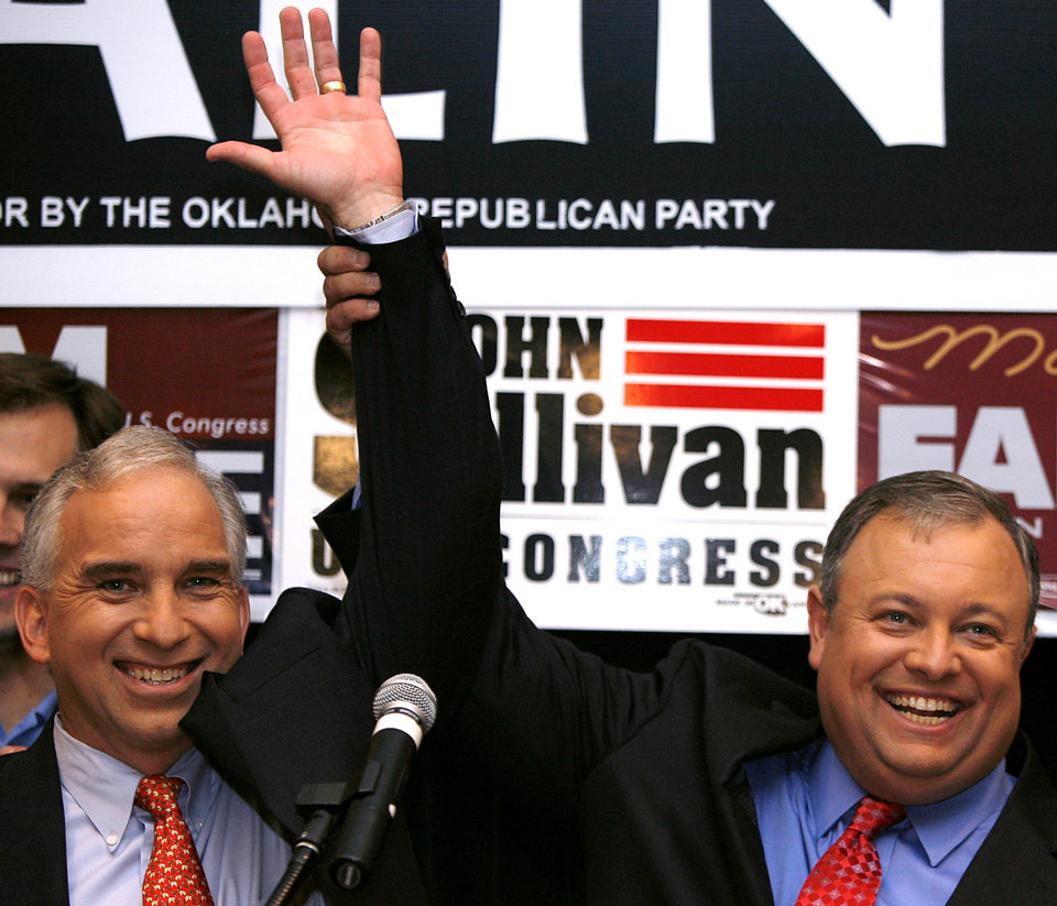 Photo - Chris Benge (left) and Glenn Coffee react to a victory for state republicans during the Republican watch party at the Oklahoma City Marriott on Northwest Expressway in oklahoma City on Tuesday Nov. 4, 2008. By John Clanton, The Oklahoman