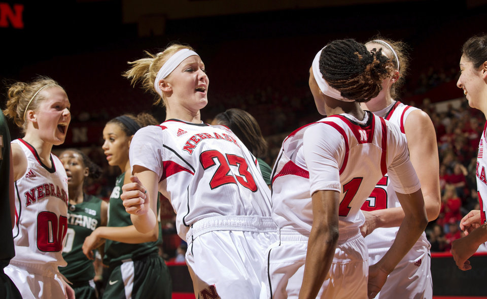 Photo - Nebraska's Emily Cady (23) and Tear'a Laudermill (1) celebrate after Laudermill scored and drew a foul against Michigan State during the second half of their NCAA college basketball game, Thursday, Jan. 24, 2013, in Lincoln, Neb. Nebraska won 59-54. (AP Photo/The World-Herald, Mark Davis) MAGS OUT; ALL NEBRASKA LOCAL BROADCAST TV OUT