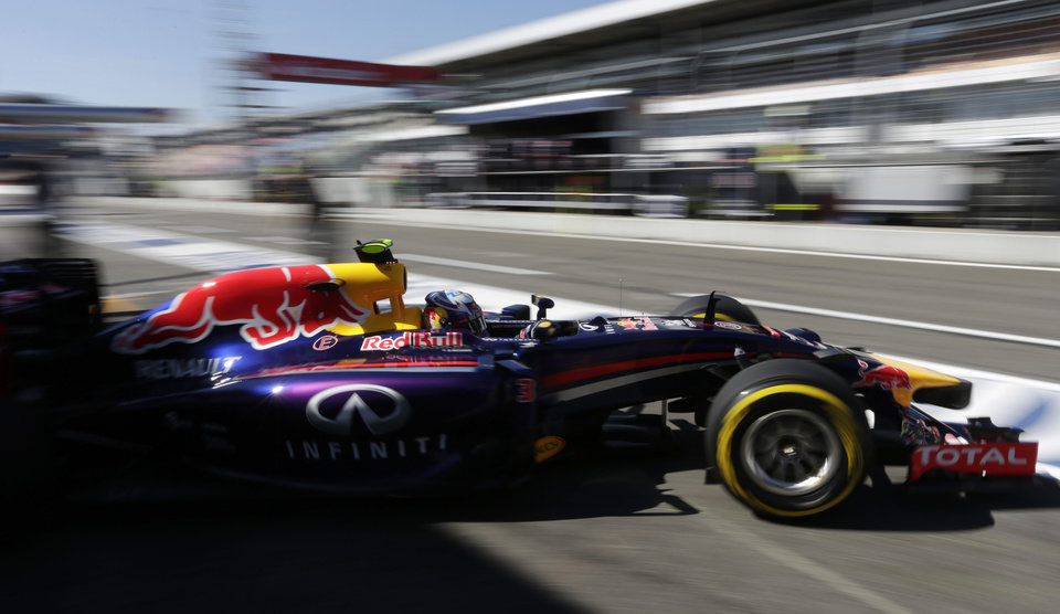Photo - Red Bull Formula 1 driver Daniel Ricciardo from Australia leaves the pit lane during the free practice session at the German Formula One Grand Prix in Hockenheim, Germany, Friday, July 18, 2014. The German Grand Prix will be held on Sunday, July 20, 2014. (AP Photo/Petr David Josek)