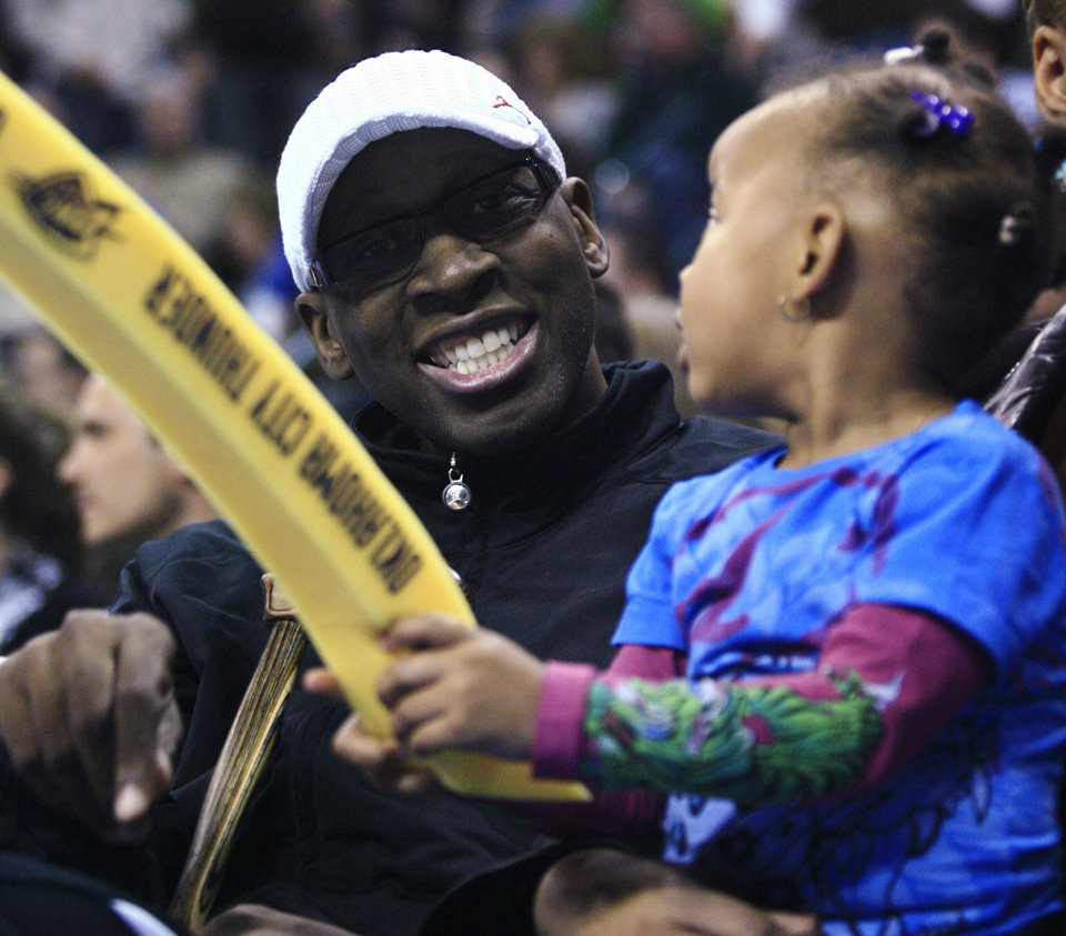 AWARD / HONOR: Wayman Tisdale, the University of Oklahoma's career scoring leader, sits with his granddaughter Bailey Braxton during the second quarter of the Oklahoma City Thunder's NBA basketball game against the San Antonio Spurs in Oklahoma City, Tuesday, April 7, 2009. Tisdale, who was selected last week to be inducted into the National Collegiate Basketball Hall of Fame in November, was honored by the Thunder. (AP Photo/Sue Ogrocki) ORG XMIT: OKSO122